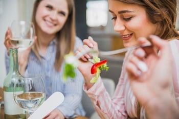 beautiful-women-enjoying-meal_23-2147807454