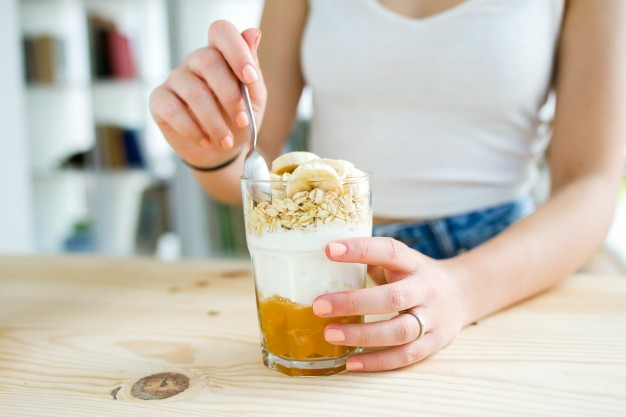 beautiful-young-woman-enjoying-breakfast-at-home_1301-4905.jpg