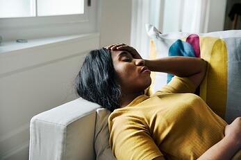 black-woman-headache-and-sleeping_53876-14547