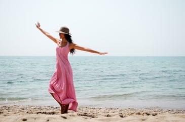 cheerful-woman-dancing-on-the-beach_1139-44.jpg