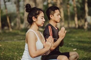 couple-meditating-with-praying-hands_23-2147645858.jpg
