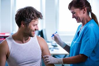 female-doctor-giving-an-injection-to-a-patient_1170-2129