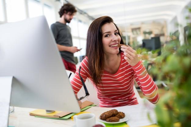 female-graphic-designer-having-a-cookie_1170-931.jpg