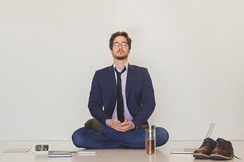 handsome-man-meditating-on-floor_23-2147791983