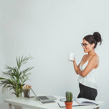 happy-businesswoman-posing-with-a-coffe-mug-in-the-office_23-2147648036.jpg