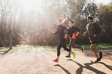healthy-athletes-running-on-a-sunny-day_23-2147600764.jpg
