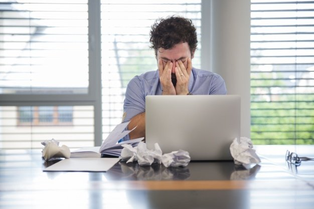 man-looking-tired-while-working_23-2147656748-1