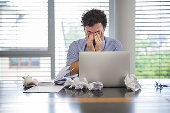 man-looking-tired-while-working_23-2147656748.jpg