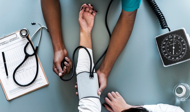 nurse-measuring-patient-blood-pressure_53876-14933