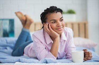 relaxed-african-woman-drinking-tea-in-bed_1262-3282.jpg