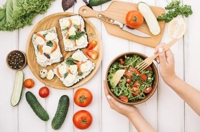 woman-putting-fork-into-salad_23-2147694442.jpg