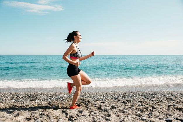 woman-running-at-the-beach_23-2147827018