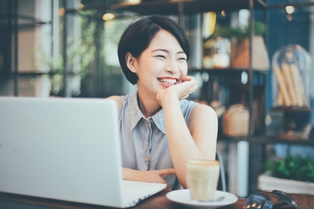 woman-smiling-with-a-coffee-and-a-laptop_1286-231.jpg