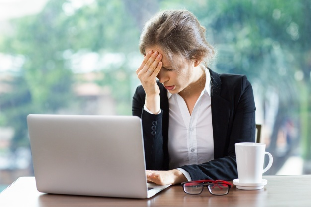woman-with-a-strong-headache-with-a-laptop-and-a-coffee_1262-734.jpg