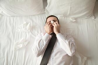 young-business-man-sick-in-bed_1163-1469.jpg