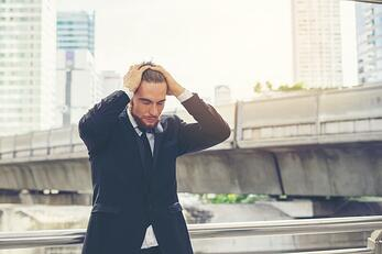 young-businessman-hand-over-on-head-feel-stressed-about-work_1150-2662