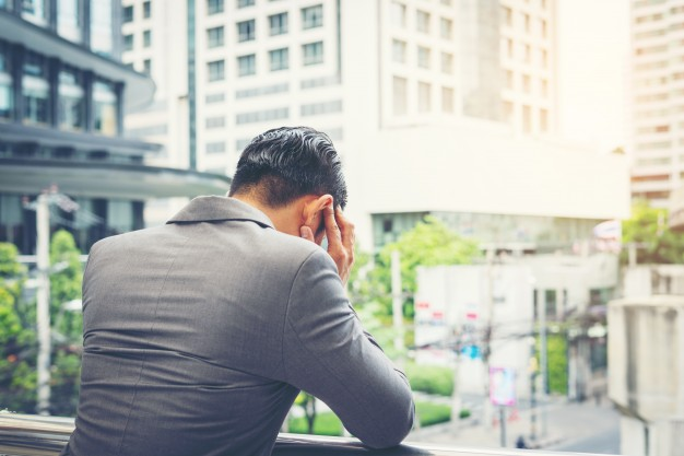 young-businessman-stressed-while-go-to-work-business-people-concept_1150-2467