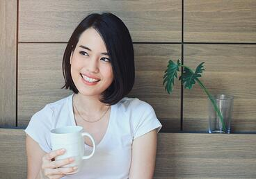 young-happy-woman-in-casual-clothes-relaxing-on-bed-while-drinking-tea-or-coffee-lifestyle-and-wellness-concept_1356-76.jpg